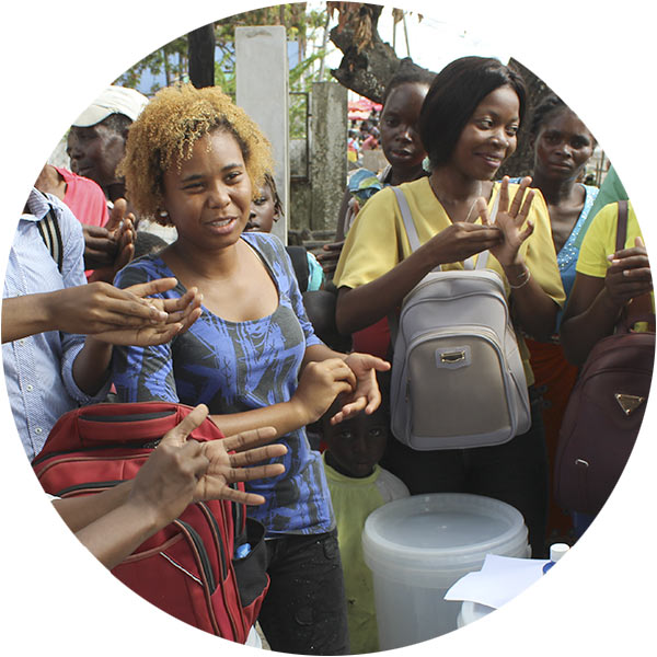 Health Worker with Water Containers